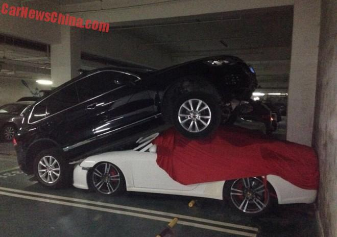 Chinese woman crashes Volkswagen Touareg on top of a Porsche in China