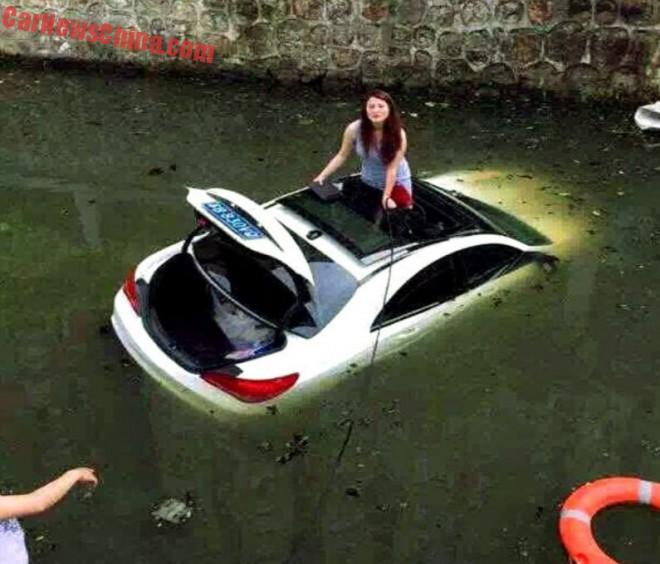 Chinese Woman drives Mercedes-Benz CLS into a Canal