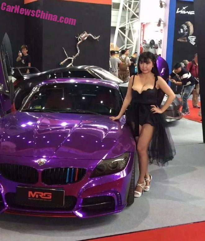 Happy Chinese car girls pumps up the Airbags on the Tuning Show
