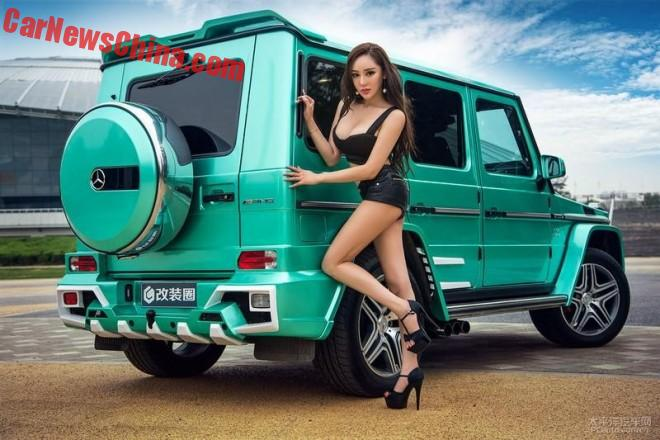 Pretty Chinese Girl gets up Close to a shiny green Mercedes-Benz G-Class