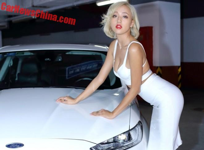Blond Chinese Girl Gets Up Close To A Ford Mondeo