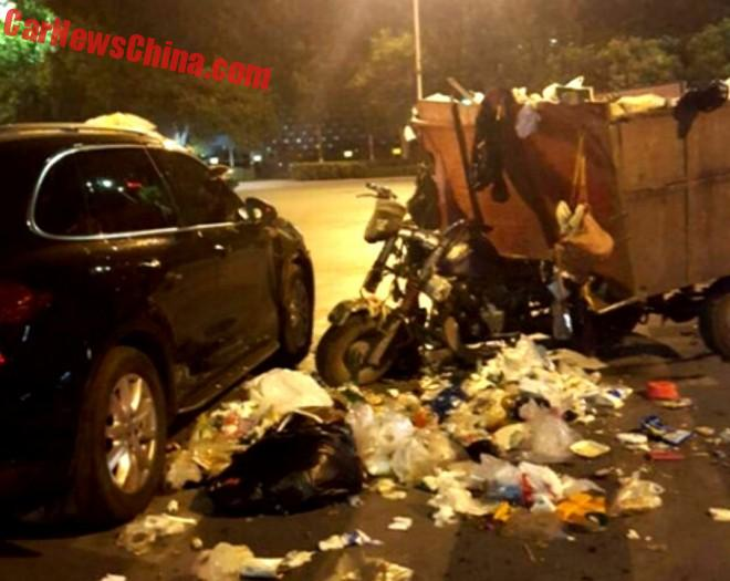Trash Tricycle Hits Porsche Cayenne In China