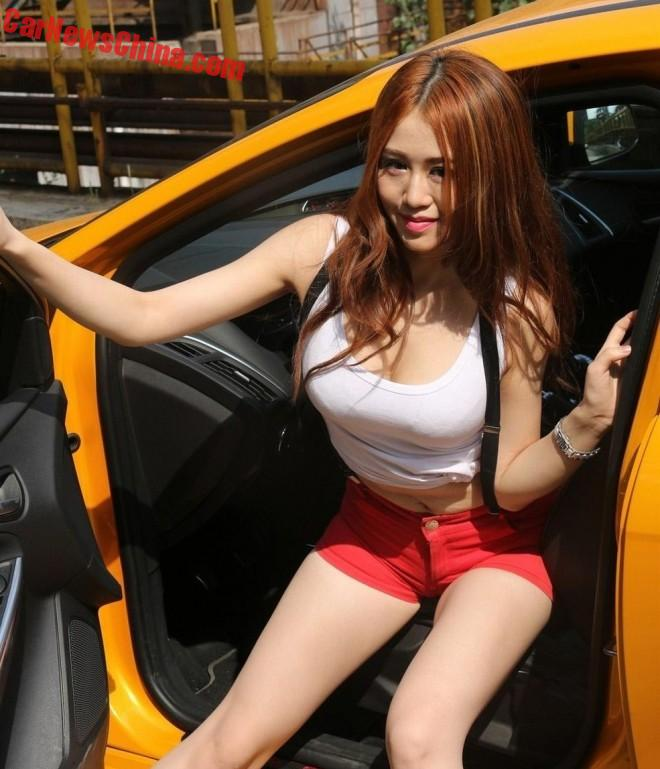Pretty Chinese Car Girl Focuses On A Ford Focus ST